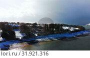 Купить «Beautiful river and snowy landscape during winter 4k», видеоролик № 31921316, снято 28 марта 2018 г. (c) Wavebreak Media / Фотобанк Лори