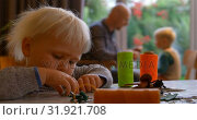 Купить «Girl playing with keychain on a table at home 4k», видеоролик № 31921708, снято 28 мая 2018 г. (c) Wavebreak Media / Фотобанк Лори
