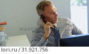 Купить «Businessman talking on telephone in office 4k », видеоролик № 31921756, снято 21 февраля 2018 г. (c) Wavebreak Media / Фотобанк Лори
