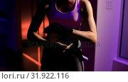Купить «Woman wearing hand wrap in fitness studio », видеоролик № 31922116, снято 25 мая 2018 г. (c) Wavebreak Media / Фотобанк Лори