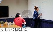 Купить «Businesswoman explaining her colleagues on whiteboard in a modern office 4k», видеоролик № 31922124, снято 6 июня 2017 г. (c) Wavebreak Media / Фотобанк Лори