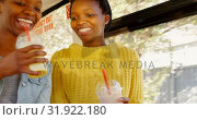 Купить «Twin sisters taking selfie with mobile phone in the bus 4k», видеоролик № 31922180, снято 6 мая 2018 г. (c) Wavebreak Media / Фотобанк Лори