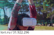 Купить «Woman wearing virtual goggles», видеоролик № 31922296, снято 26 марта 2019 г. (c) Wavebreak Media / Фотобанк Лори