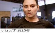 Купить «Woman walking in fitness studio 4k», видеоролик № 31922548, снято 26 июня 2018 г. (c) Wavebreak Media / Фотобанк Лори