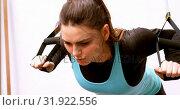 Купить «Determined beautiful Caucasian woman exercising in fitness studio 4k», видеоролик № 31922556, снято 26 июня 2018 г. (c) Wavebreak Media / Фотобанк Лори