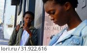 Купить «Woman looking at twin sister in the city 4k», видеоролик № 31922616, снято 6 мая 2018 г. (c) Wavebreak Media / Фотобанк Лори