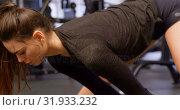 Купить «Woman exercising in fitness studio 4k», видеоролик № 31933232, снято 26 июня 2018 г. (c) Wavebreak Media / Фотобанк Лори
