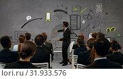 Купить «Businessman presenting to colleagues», видеоролик № 31933576, снято 27 марта 2019 г. (c) Wavebreak Media / Фотобанк Лори