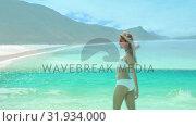 Купить «Woman dancing on the beach», видеоролик № 31934000, снято 5 апреля 2019 г. (c) Wavebreak Media / Фотобанк Лори
