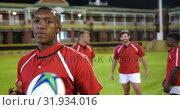 Купить «Male rugby player standing with rugby ball in stadium 4k», видеоролик № 31934016, снято 16 января 2019 г. (c) Wavebreak Media / Фотобанк Лори