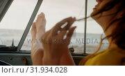 Купить «Woman relaxing with feet up in camper van 4k», видеоролик № 31934028, снято 9 января 2019 г. (c) Wavebreak Media / Фотобанк Лори