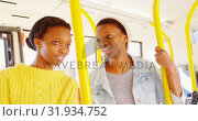 Купить «Twin sister showing something her sibling outside in the bus 4k», видеоролик № 31934752, снято 6 мая 2018 г. (c) Wavebreak Media / Фотобанк Лори
