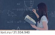 Купить «Female student writing a mathematical equation on the board», видеоролик № 31934940, снято 27 марта 2019 г. (c) Wavebreak Media / Фотобанк Лори