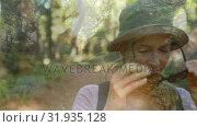 Купить «Hiker walking on a forest trail», видеоролик № 31935128, снято 18 апреля 2019 г. (c) Wavebreak Media / Фотобанк Лори