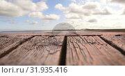 Купить «Bird flying in the sky with a view of a wooden plank», видеоролик № 31935416, снято 27 марта 2019 г. (c) Wavebreak Media / Фотобанк Лори