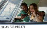 Купить «Couple using mobile phone in camper van 4k», видеоролик № 31935676, снято 9 января 2019 г. (c) Wavebreak Media / Фотобанк Лори