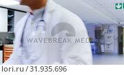 Купить «Medical team discussing over report 4k», видеоролик № 31935696, снято 26 января 2019 г. (c) Wavebreak Media / Фотобанк Лори