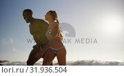 Купить «Couple walking hand in hand on the beach 4k», видеоролик № 31936504, снято 24 января 2019 г. (c) Wavebreak Media / Фотобанк Лори