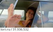 Купить «Woman relaxing with feet up in camper van 4k», видеоролик № 31936532, снято 9 января 2019 г. (c) Wavebreak Media / Фотобанк Лори