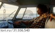Купить «Man relaxing in camper van at beach 4k», видеоролик № 31936540, снято 9 января 2019 г. (c) Wavebreak Media / Фотобанк Лори