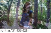 Купить «Woman walking in a forest», видеоролик № 31936628, снято 18 апреля 2019 г. (c) Wavebreak Media / Фотобанк Лори