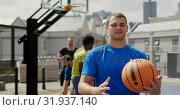 Купить «Basketball player standing with basketball 4k», видеоролик № 31937140, снято 30 января 2019 г. (c) Wavebreak Media / Фотобанк Лори