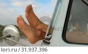 Купить «Woman relaxing with feet up in camper van 4k», видеоролик № 31937396, снято 9 января 2019 г. (c) Wavebreak Media / Фотобанк Лори