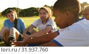 Купить «Female soccer team in break time talking on soccer field. 4k», видеоролик № 31937760, снято 18 апреля 2019 г. (c) Wavebreak Media / Фотобанк Лори