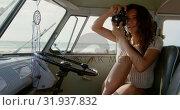 Купить «Young woman taking photo with digital camera 4k», видеоролик № 31937832, снято 9 января 2019 г. (c) Wavebreak Media / Фотобанк Лори