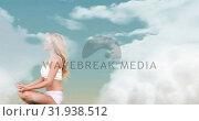 Купить «Woman meditating in the sky 4k», видеоролик № 31938512, снято 25 апреля 2019 г. (c) Wavebreak Media / Фотобанк Лори