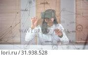 Купить «Girl wearing a virtual reality headset solving puzzles», видеоролик № 31938528, снято 25 апреля 2019 г. (c) Wavebreak Media / Фотобанк Лори