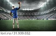 Купить «American football player facing his fans», видеоролик № 31939032, снято 25 апреля 2019 г. (c) Wavebreak Media / Фотобанк Лори