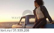 Купить «Woman sitting on trunk of pickup truck at beach 4k», видеоролик № 31939208, снято 8 февраля 2019 г. (c) Wavebreak Media / Фотобанк Лори