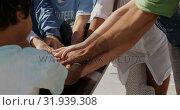 Купить «Volunteers forming hand stack on the beach 4k», видеоролик № 31939308, снято 14 февраля 2019 г. (c) Wavebreak Media / Фотобанк Лори