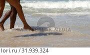 Купить «Couple walking together in sea 4k», видеоролик № 31939324, снято 14 февраля 2019 г. (c) Wavebreak Media / Фотобанк Лори