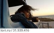 Купить «Woman leaning on window of pickup truck at beach 4k», видеоролик № 31939416, снято 8 февраля 2019 г. (c) Wavebreak Media / Фотобанк Лори