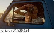 Купить «Woman taking photo with digital camera in pickup truck at beach 4k», видеоролик № 31939624, снято 8 февраля 2019 г. (c) Wavebreak Media / Фотобанк Лори