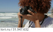 Купить «Woman taking photo with digital camera on the beach 4k», видеоролик № 31947632, снято 14 февраля 2019 г. (c) Wavebreak Media / Фотобанк Лори