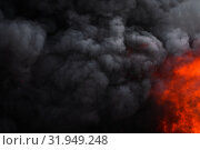 Купить «Flames strong red fire, dramatic clouds motion blur of black smoke covered sky», фото № 31949248, снято 18 апреля 2019 г. (c) А. А. Пирагис / Фотобанк Лори