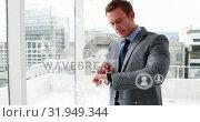 Купить «A businessman using his digital watch 4k», видеоролик № 31949344, снято 14 мая 2019 г. (c) Wavebreak Media / Фотобанк Лори