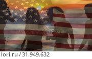 Купить «Group of friends dancing in the beach and an American flag for fourth of July.», видеоролик № 31949632, снято 11 июня 2019 г. (c) Wavebreak Media / Фотобанк Лори