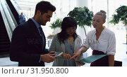 Купить «Business people discussing over a file in the lobby at office 4k», видеоролик № 31950800, снято 21 марта 2019 г. (c) Wavebreak Media / Фотобанк Лори