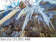 Купить «Long icicles dangle from the rock. Bottom view.», фото № 31951448, снято 23 апреля 2019 г. (c) Акиньшин Владимир / Фотобанк Лори