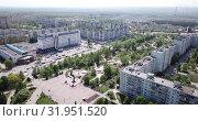 Купить «Aerial view of modern residential areas of Stary Oskol in sunny spring day, Russia», видеоролик № 31951520, снято 4 мая 2019 г. (c) Яков Филимонов / Фотобанк Лори