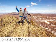 Купить «Two friends are standing on the top of the mountain, enjoying the ascent.», фото № 31951736, снято 25 апреля 2019 г. (c) Акиньшин Владимир / Фотобанк Лори