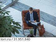 Купить «Businessman using mobile phone in the lobby at modern office», фото № 31951840, снято 21 марта 2019 г. (c) Wavebreak Media / Фотобанк Лори