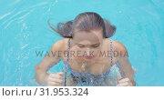 Купить «Woman swimming in pool at backyard 4k», видеоролик № 31953324, снято 12 марта 2019 г. (c) Wavebreak Media / Фотобанк Лори