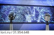 Купить «Two robot hands and a big screen with glowing circuit board and flashing hand», видеоролик № 31954648, снято 8 июля 2019 г. (c) Wavebreak Media / Фотобанк Лори
