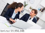 Купить «young man and smiling woman coworkers talking in firm office», фото № 31956348, снято 17 сентября 2019 г. (c) Яков Филимонов / Фотобанк Лори
