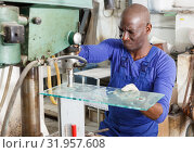 Купить «glass factory worker drilling bores in glass», фото № 31957608, снято 16 мая 2018 г. (c) Яков Филимонов / Фотобанк Лори